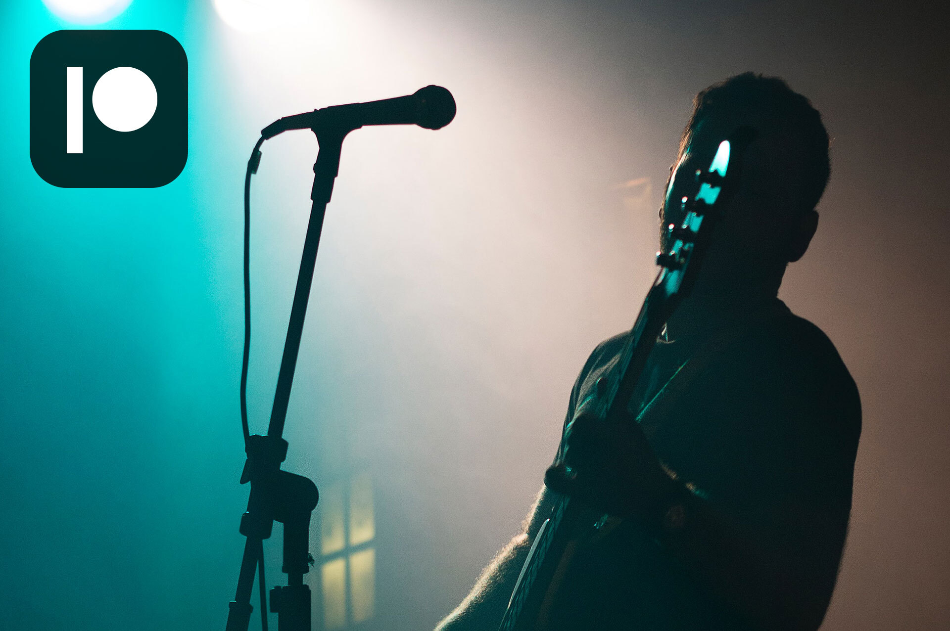 Bass player on stage in the fog. Contribution image for Patreon blogpost
