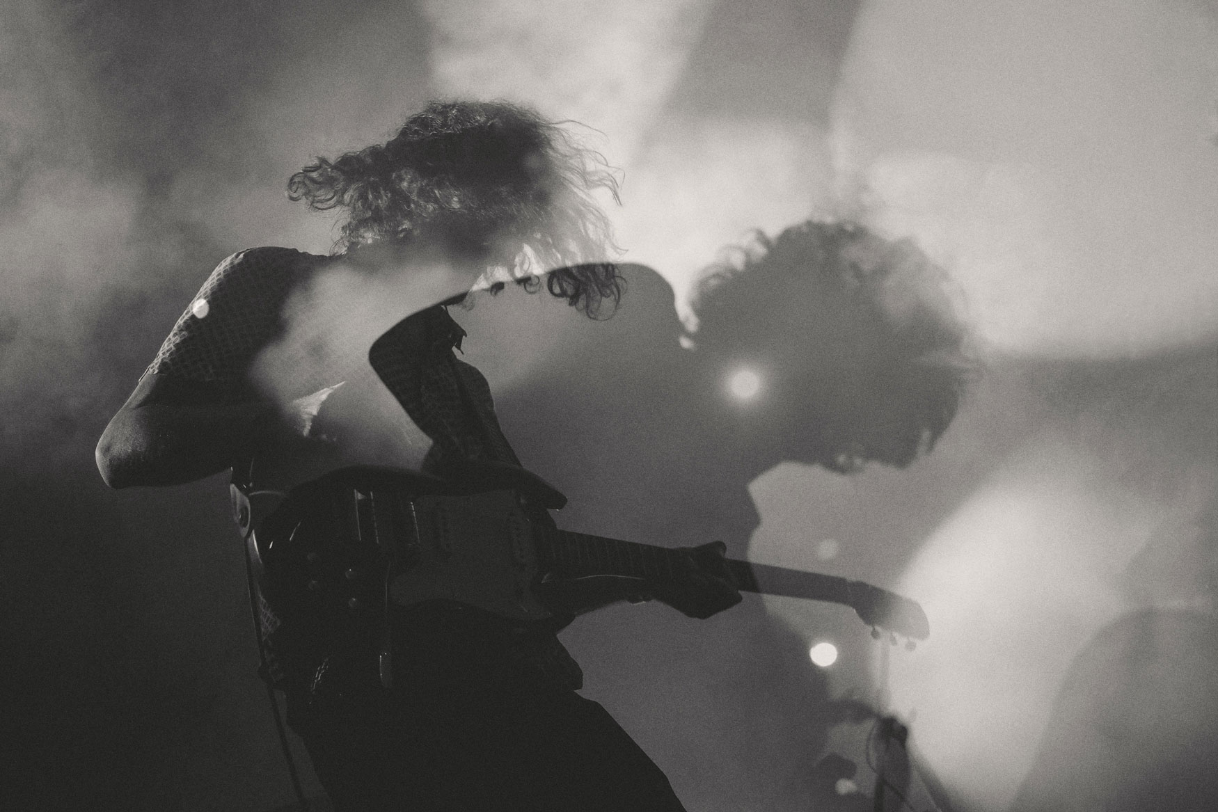 Guitarist on stage, shadow play - contribution image